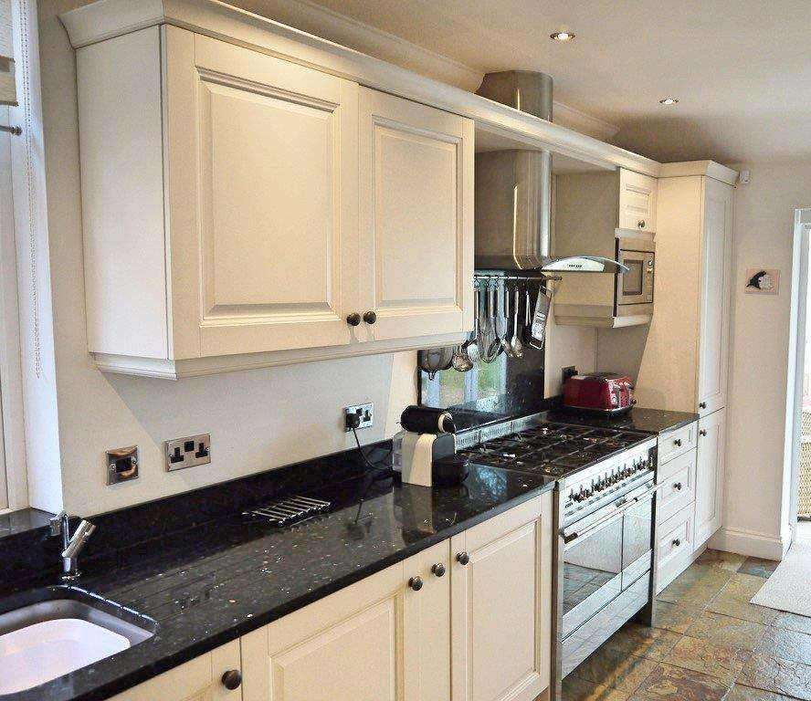 Black Kitchen Units Sale: Pale Cream Units, Black Granite Worktops