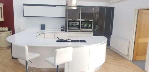 Metris Ex Display Kitchen Lava Gloss Handless Curved, Silestone Worktops, AEG Appliances