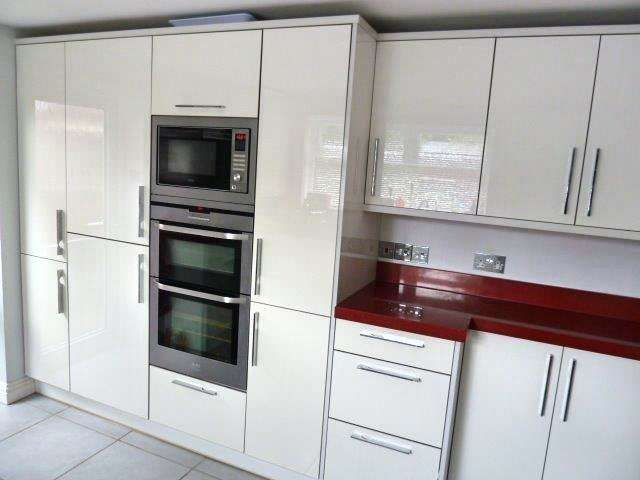 Gloss White Kitchen Red Composite Worktops And Miele