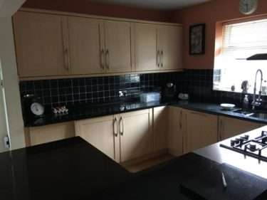 Pear Wood, Shaker Style Kitchen with Black Granite Worktops & Appliances
