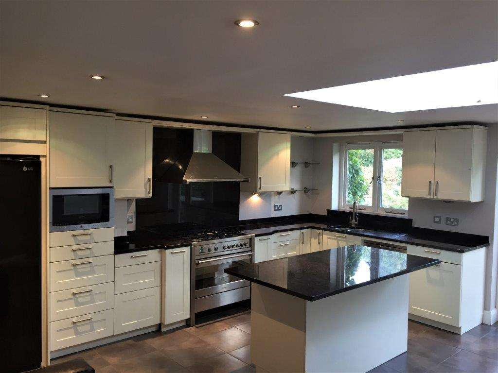 Hacker Cream Matt Shaker Style Kitchen Including Appliances With 30mm Black Fleck Granite 1018449