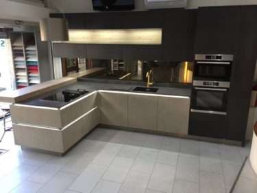 NOLTE Natural Kitchen with Concrete & Blue Steel Doors. Bosch Appliances with Neolithic Krater Worktops + LED lighting