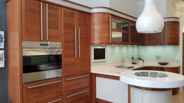 Stoneham Elan Black Walnut Doors Base & Wall Units & Breakfast Bar, Corian Worktops, Subzero, Wolf & Miele