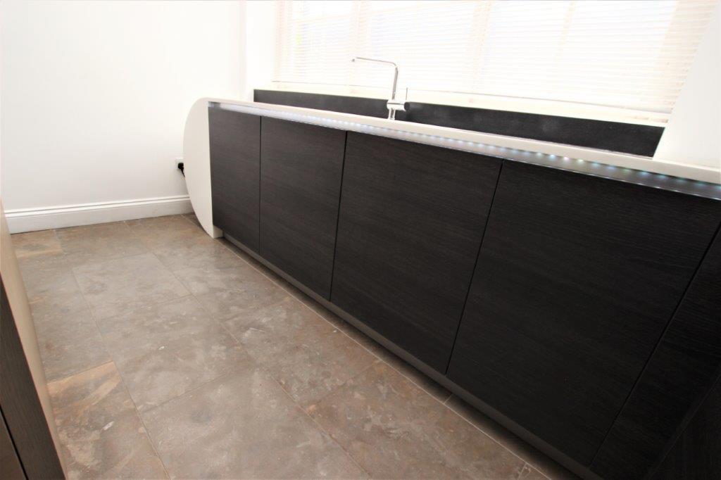 Hacker Handless Kitchen Tall Units Corian Worktops