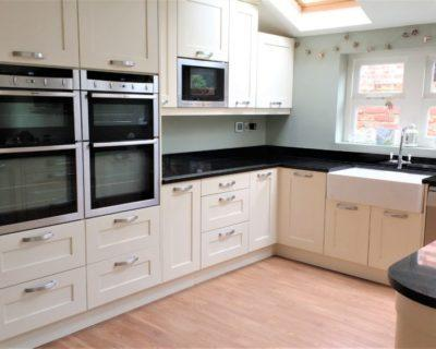 Modern Cream Shaker Style Kitchen with Black Granite Worktops & Neff Appliances