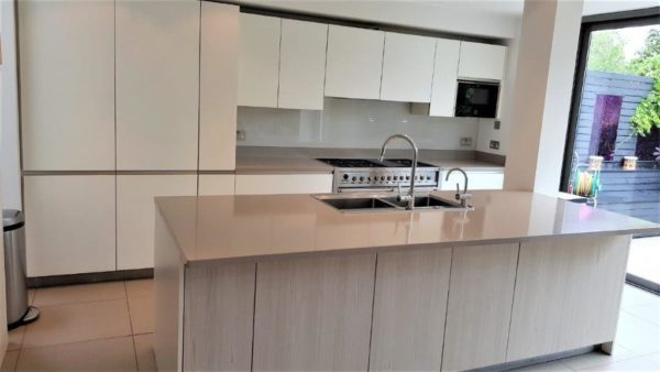 Rational Atmos White Glass Kitchen with Silestone Composite Worktops & Appliances
