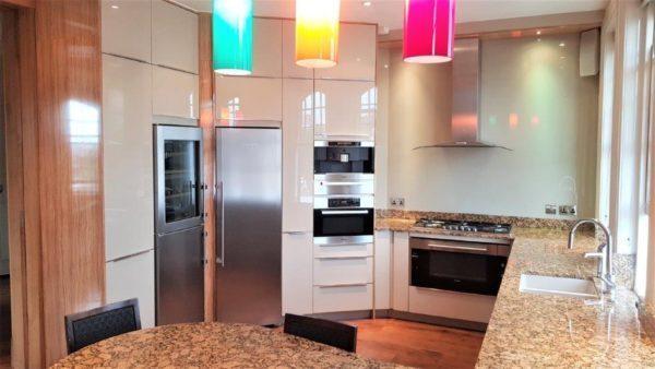 Hacker High Gloss Cappuccino AV 4030 Kitchen, Magnolia Wood Surrounds, Granite Worktops & Liebherr Appliances