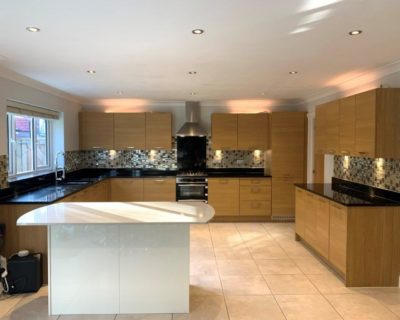 Immaculate Large Symphony Oak Effect Kitchen filled Appliances and Black Granite Worktops