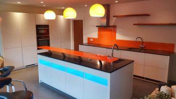 Alno Glass Gloss Kitchen with Composite Worktops & Siemens Appliances