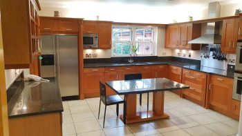 Beautiful Tan kitchen & Dining Table with granite & appliances