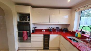 Handless Cream Gloss Kitchen with Quartz Worktops & Appliances