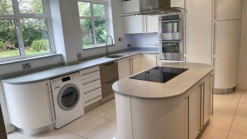 Modern White Matt Satin Rounded Kitchen designed by Marazzi Kitchens