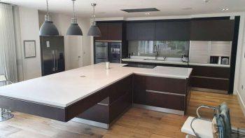 Kulhmann wood Kitchen with huge Island & Corian Worktops