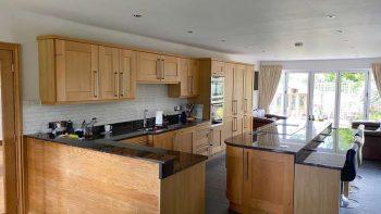 Errin Oak Shaker Kitchen & Island with Granite Worktops & Appliances