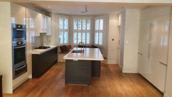 Poggenpohl Cream & Wood Veneer Kitchen + Stone Worktops & Miele & Gaggenau Appliances
