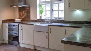 Painted Cream Shaker Kitchen with Corian Worktops & Appliances